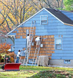 Home Improvement. Workers painting a house exterior with Royalty Free Stock Image