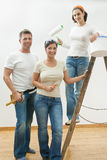 Home improvement. Young people doing home improvement, posing with tools and ladder, smiling stock photo