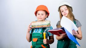 Home improvement activities. Future profession. Kids girls planning renovation. Children sisters run renovation their. Room. Amateur renovation. Sisters royalty free stock photos