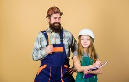 Home improvement activity. Kid girl planning renovation. Child renovation room. Family remodeling house. Home remodel. And renovation. Father and daughter hard stock photos