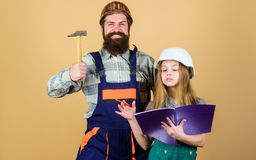 Home improvement activity. Kid girl planning renovation. Child renovation room. Family remodeling house. Little fathers. Helper. Father bearded men and daughter royalty free stock photography