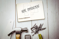 Home improvement against blueprint Stock Photography