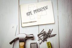 Home improvement against blueprint Stock Photography