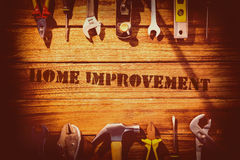 Home improvement against desk with tools Stock Photography