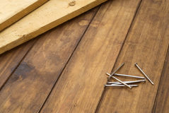Home improvement background. Wooden planks and nails on home improvement table work background Stock Photo
