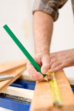 Home improvement - close-up of man measure wood Royalty Free Stock Photos