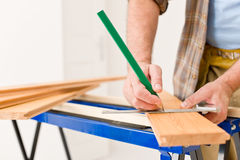 Home improvement - close-up of man measure wood Stock Photos