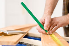 Home improvement - close-up of man measure wood Royalty Free Stock Images