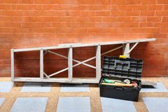 Home improvement concept with ladder and toolbox. Home improvement concept with ladder, toolbox and tools Royalty Free Stock Images