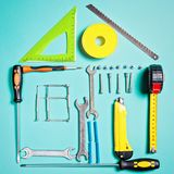 Home improvement concept. Set work hand tool for construction or repair of house. Rebuilding DIY. Group of tools in shape house Royalty Free Stock Photo