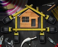Home Improvement Concept - Work Tools and House Royalty Free Stock Photos