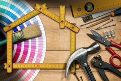 Home Improvement Concept - Work Tools and House Stock Image
