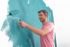Home improvement. Creative color wall painting man royalty free stock image