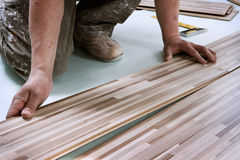 Home improvement, floor installation. Home improvement, wooden floor panels installation royalty free stock photo