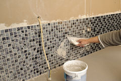 Home improvement, grouting tiles Royalty Free Stock Photography