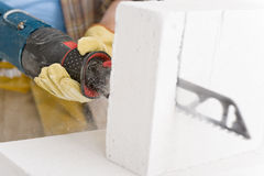 Home improvement - handyman cut brick with saw Stock Photography