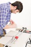 Home improvement - handyman cut tile Royalty Free Stock Image