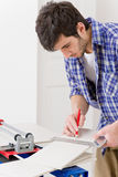 Home improvement - handyman cut tile Stock Photo