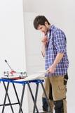 Home improvement - handyman cut tile Stock Images