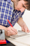 Home improvement - handyman cut tile Royalty Free Stock Image