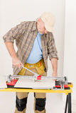 Home improvement - handyman cut tile Royalty Free Stock Photo