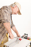 Home improvement - handyman cut tile Stock Image