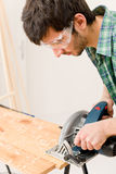 Home improvement - handyman cut wood with jigsaw Royalty Free Stock Images