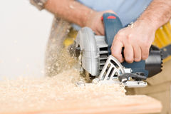 Home improvement - handyman cut wood with jigsaw. In workshop Stock Image