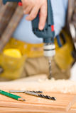 Home improvement - handyman drilling wood. In workshop Royalty Free Stock Images