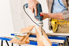 Home improvement - handyman drilling wood. In workshop Royalty Free Stock Image