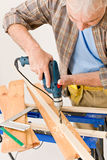Home improvement - handyman drilling wood. In workshop Stock Photography