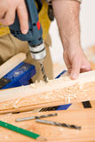 Home improvement - handyman drilling wood Stock Photography