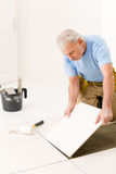 Home improvement - handyman laying ceramic tile Stock Images
