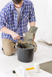 Home improvement - handyman laying tile Stock Photos