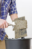 Home improvement - handyman laying tile. Home improvement, renovation - handyman laying tile, trowel with mortar royalty free stock photos