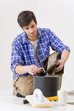 Home improvement - handyman laying tile Royalty Free Stock Images