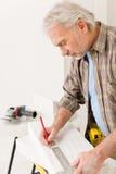 Home improvement - handyman measure porous brick Stock Images