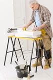 Home improvement - handyman measure porous brick Royalty Free Stock Photography