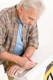 Home improvement - handyman measure porous brick Stock Photography