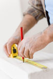 Home improvement - handyman measure porous brick Royalty Free Stock Photos