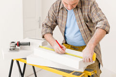 Home improvement - handyman measure porous brick Stock Image