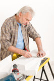 Home improvement - handyman measure porous brick Stock Photo