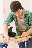 Home improvement - handyman prepare wooden floor. In workshop Royalty Free Stock Photos