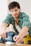 Home improvement - handyman sanding wooden floor Royalty Free Stock Photography