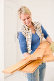 Home improvement - handywoman carry wooden plank Royalty Free Stock Photo