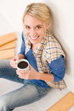 Home improvement - handywoman coffee break Stock Photo
