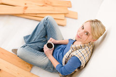 Home improvement - handywoman coffee break Royalty Free Stock Photos