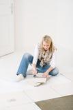 Home improvement - handywoman measuring tile. Home improvement, renovation - handywoman measuring tile Stock Photos