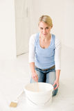 Home improvement - handywoman mixing paint royalty free stock image