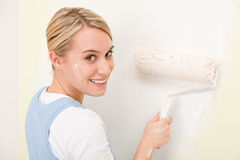 Home improvement - handywoman painting wall Royalty Free Stock Photo